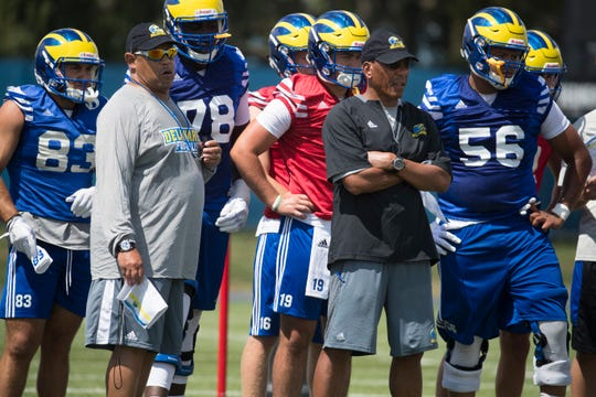 Offensive Coordinator Matt Simon, left, and Quarterbacks Coach Alex Wood watch on as the Blue Hens practice Wednesday afternoon.