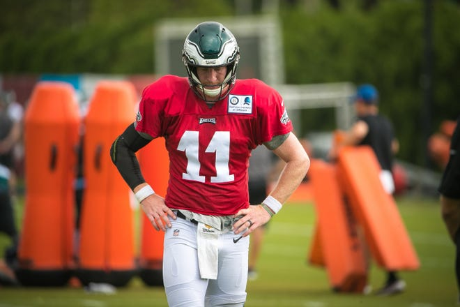 Eagles quarterback Carson Wentz pauses after going through a drill at a recent practice.