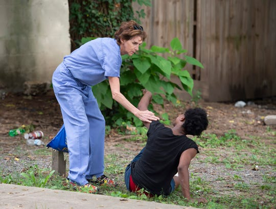 While handing out free naloxone hydrochloride, Dr. Sandy Gibney had to stop and administer a dose to a female near New Street in Dover.