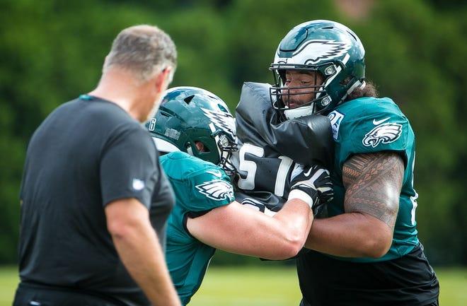 Eagles rookie Matt Pryor runs contact drills at the NovaCare Complex in Philadelphia.
