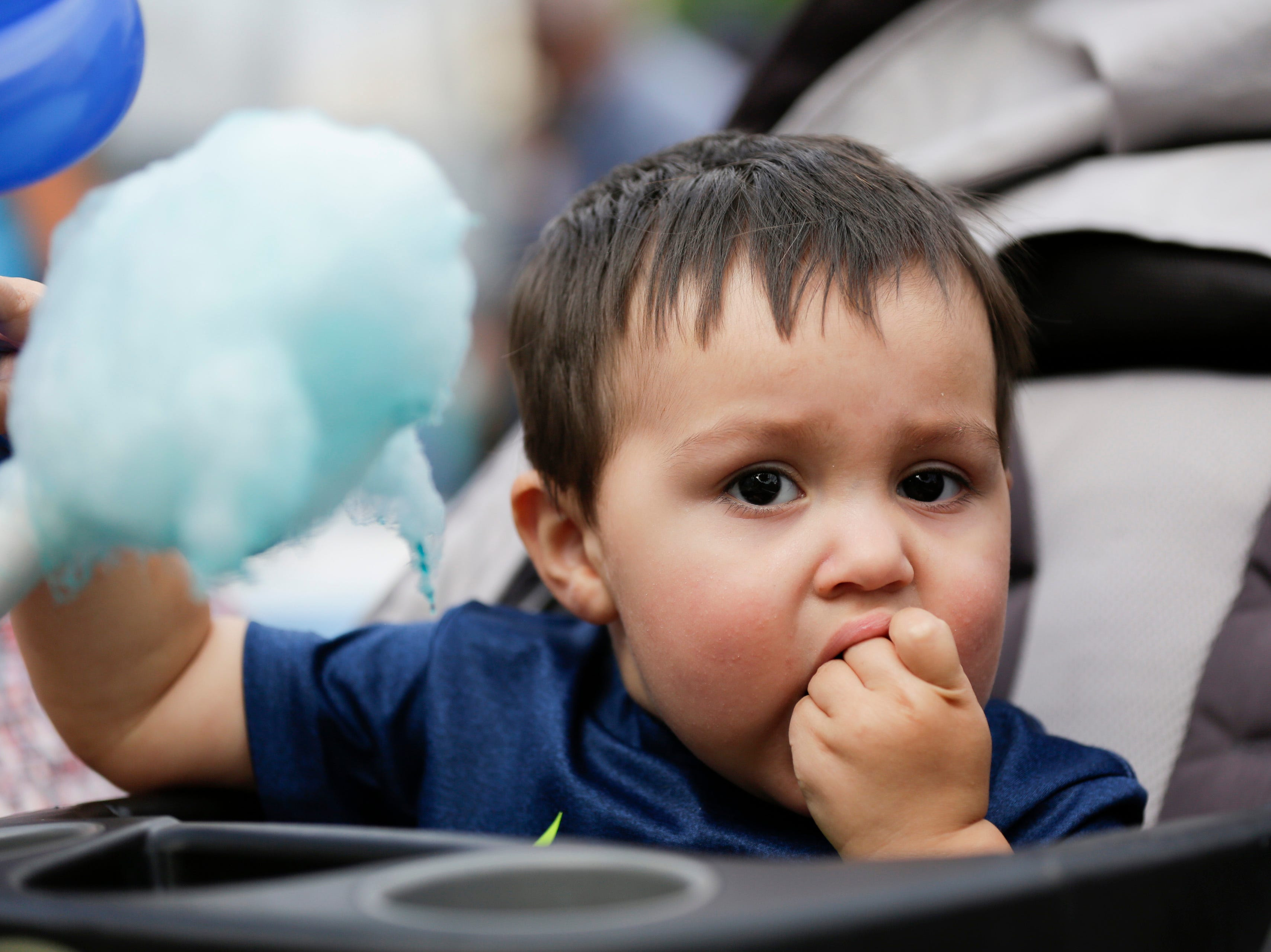 Sebastian Diaz, 1, eats cotton candy at the Wisconsin Rapids community picnic on First Avenue South and Johnson Street Wednesday, August 1, 2018.
