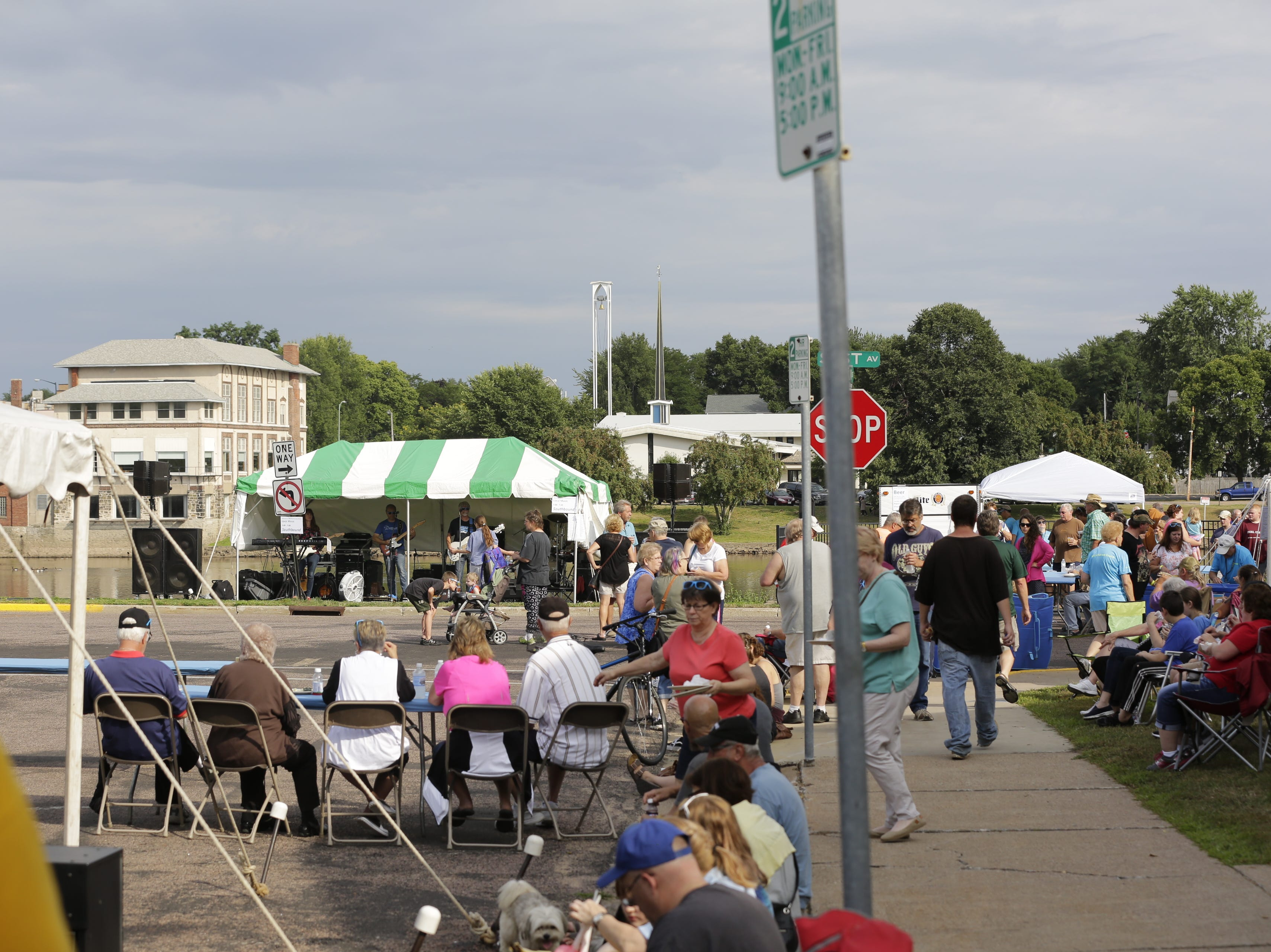 Crowds gather to hear local band Southbound play at the Wisconsin Rapids community picnic on First Avenue South and Johnson Street Wednesday, August 1, 2018.