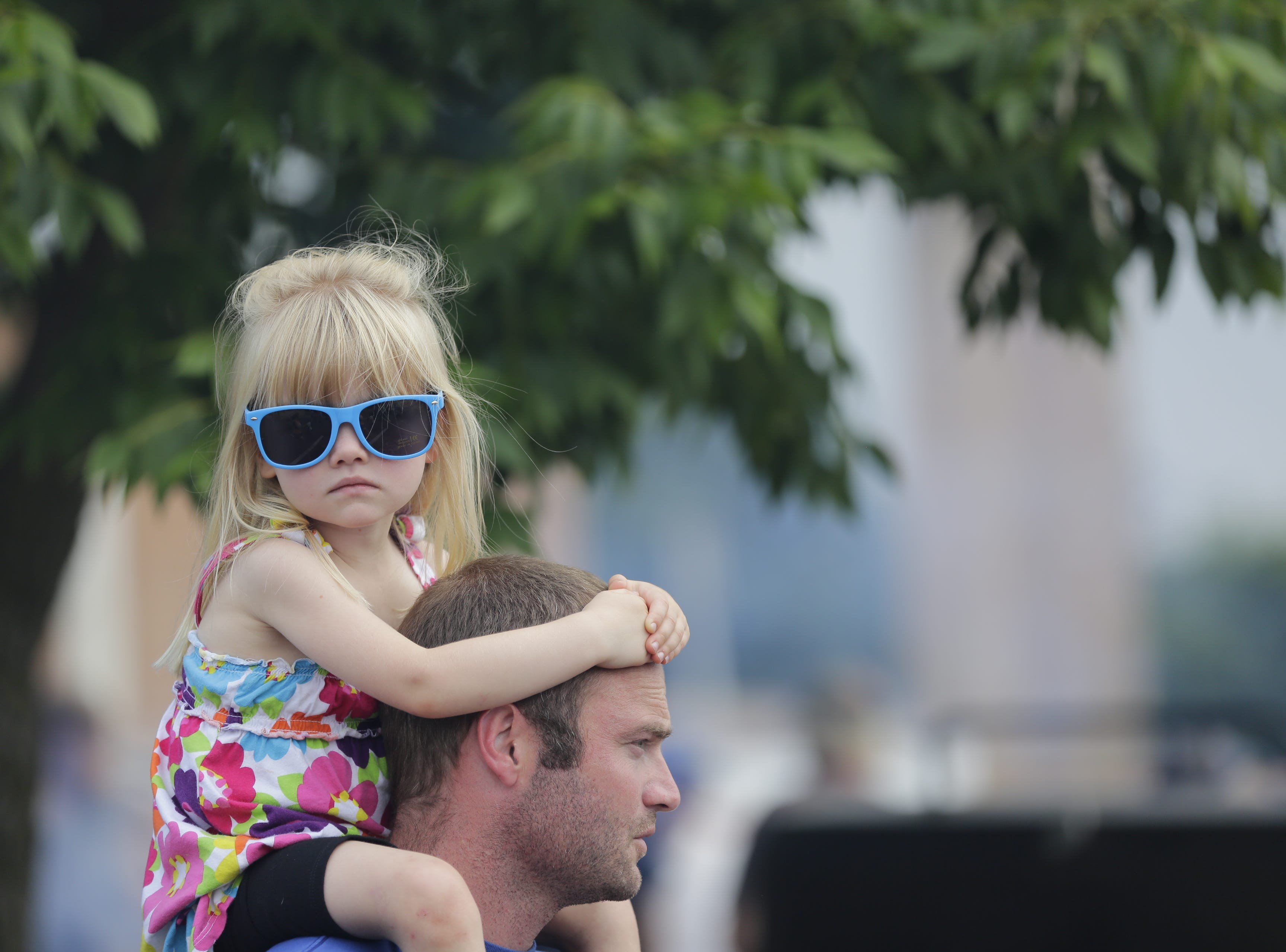 Hailey Hegg, 4, sits on the shoulders of her father Eric Hegg at the Wisconsin Rapids community picnic on First Avenue South and Johnson Street Wednesday, August 1, 2018.