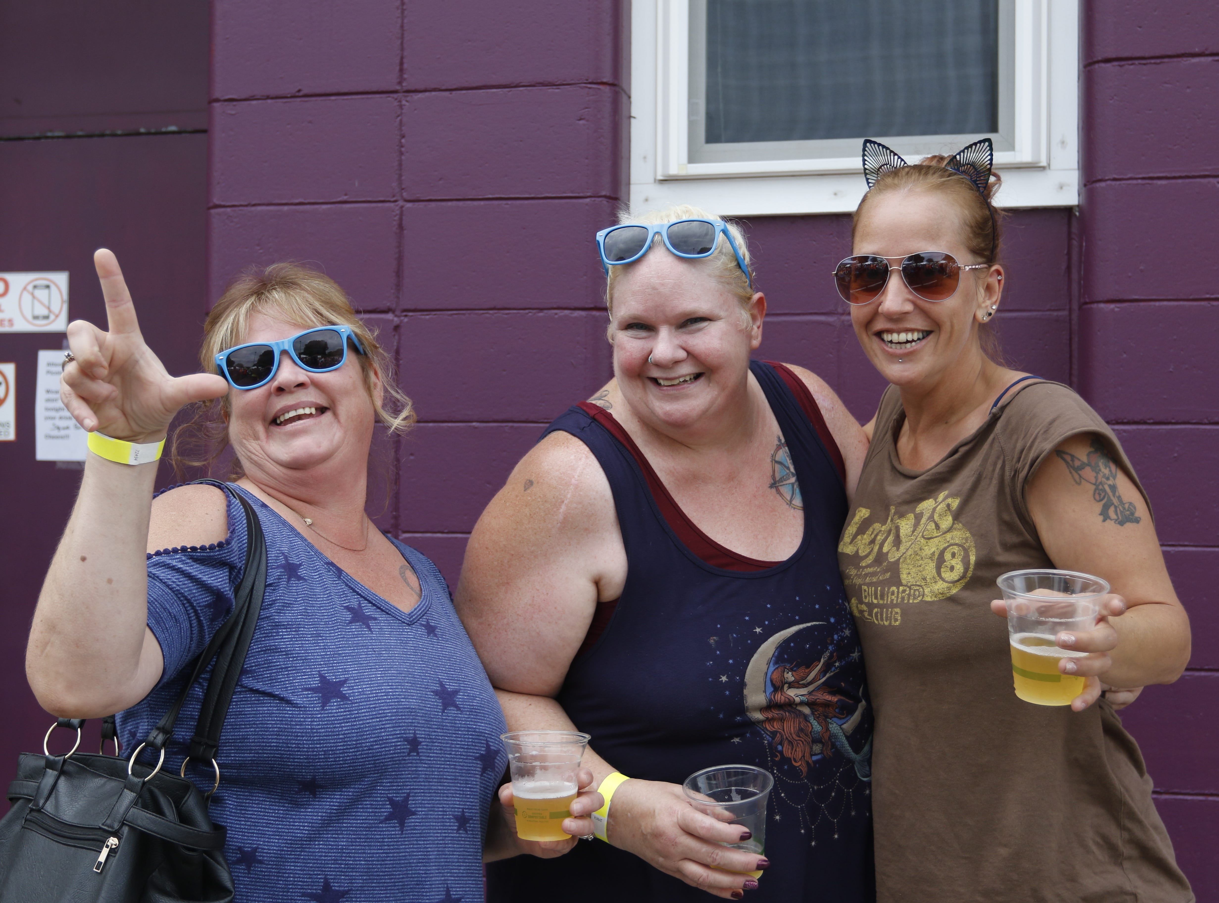 Doreen Putzkie, left, Becki Nightingale and Jen Longmore pose for a photo at the Wisconsin Rapids community picnic on First Avenue South and Johnson Street Wednesday, August 1, 2018.
