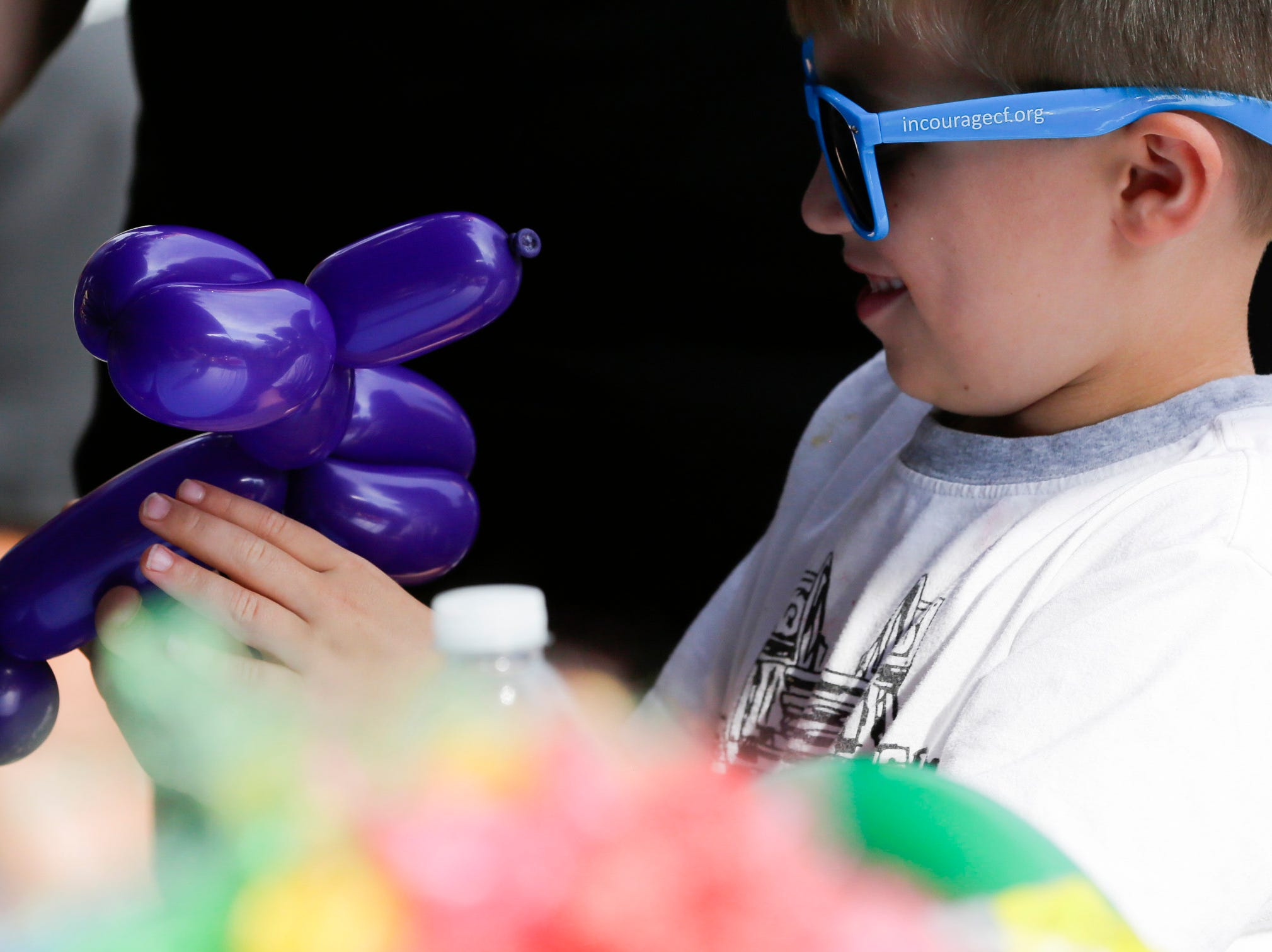Sawyer Corea, 6, smiles at his new balloon dog at the Wisconsin Rapids community picnic on First Avenue South and Johnson Street Wednesday, August 1, 2018.