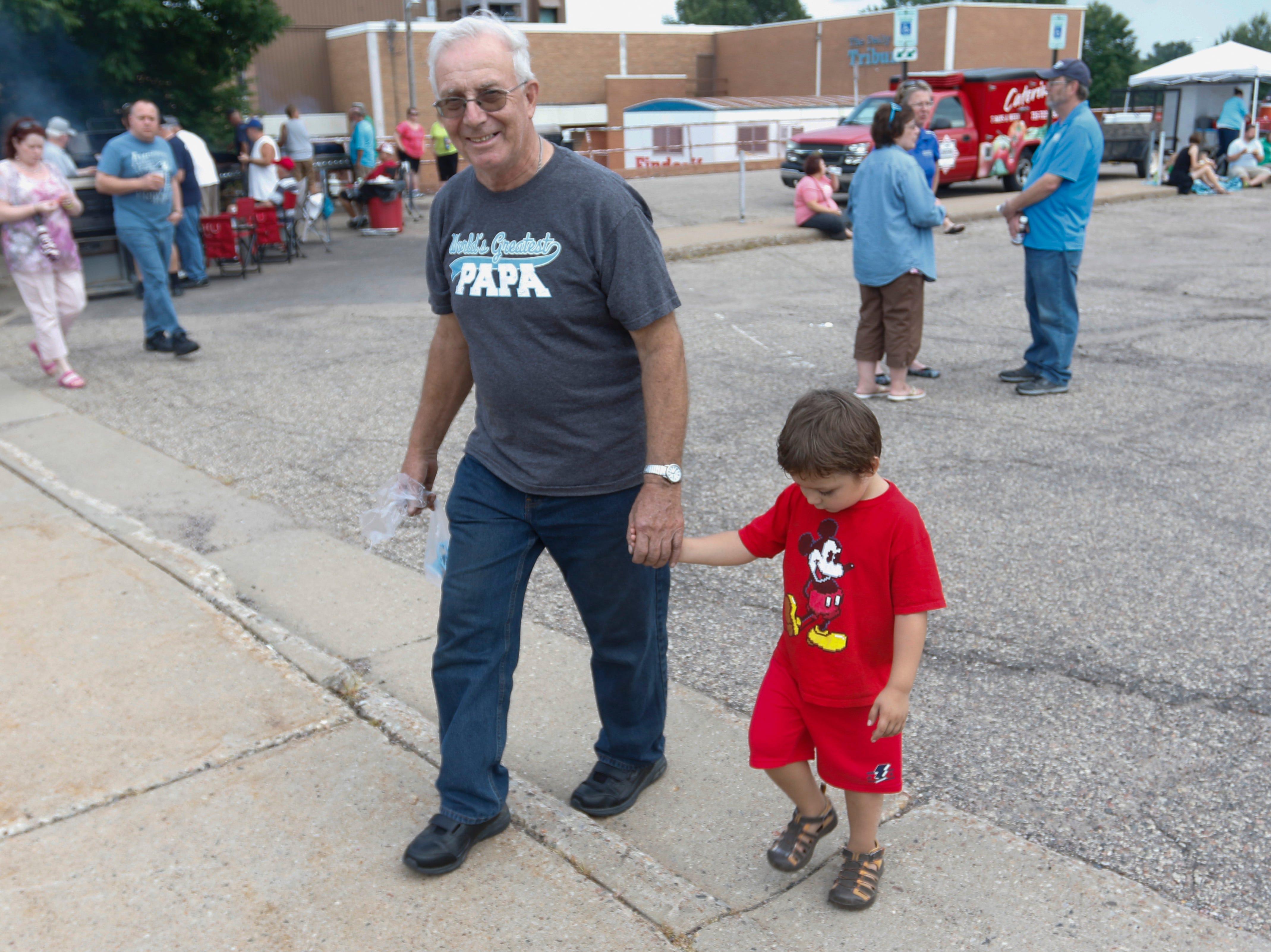 Grandpa Al Zurkowski walks with his grandson Joshua Zurkowski, 3, at the Wisconsin Rapids community picnic on First Avenue South and Johnson Street Wednesday, August 1, 2018.