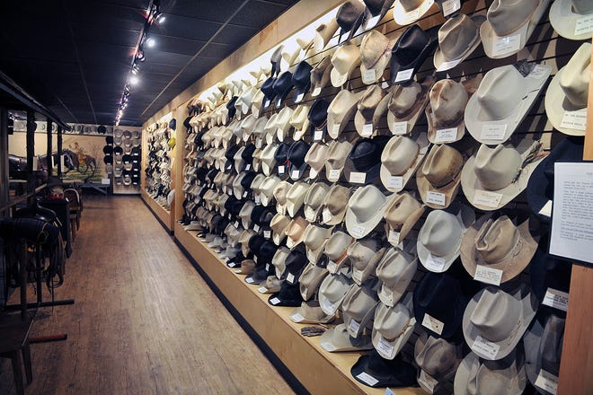 TORIN HALSEY/TIMES RECORD NEWS File Photo  Five hundred cowboy hats are on display as Nat's Hats at the Museum of North Texas History, an exhibit donated by Nat Fleming, who owned and operated The Cow Lot Western Wear store for more than 50 years. As his customers purchased new hats, their old one would be displayed on the walls of the store. Many farming and ranching icons of the North Texas area have their hats in the collection. Fleming died Wednesday.