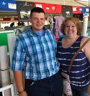 Kim Katzenmeyer gets a photo with Waylon Klitzman, a sophomore at Evansville High School and former student of Katzenmeyer's.