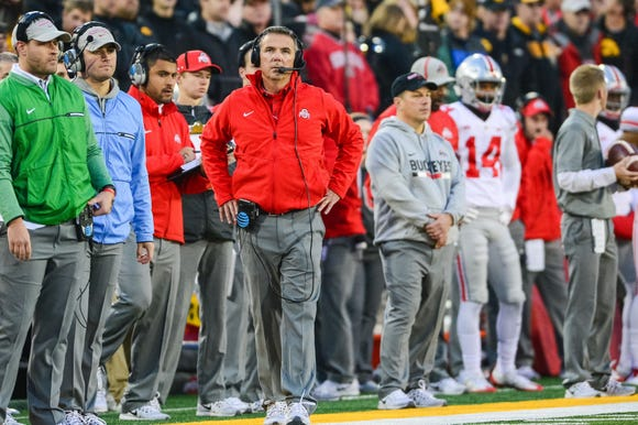 Urban Meyer watches from the sideline during Ohio State's loss to Iowa in 2017.
