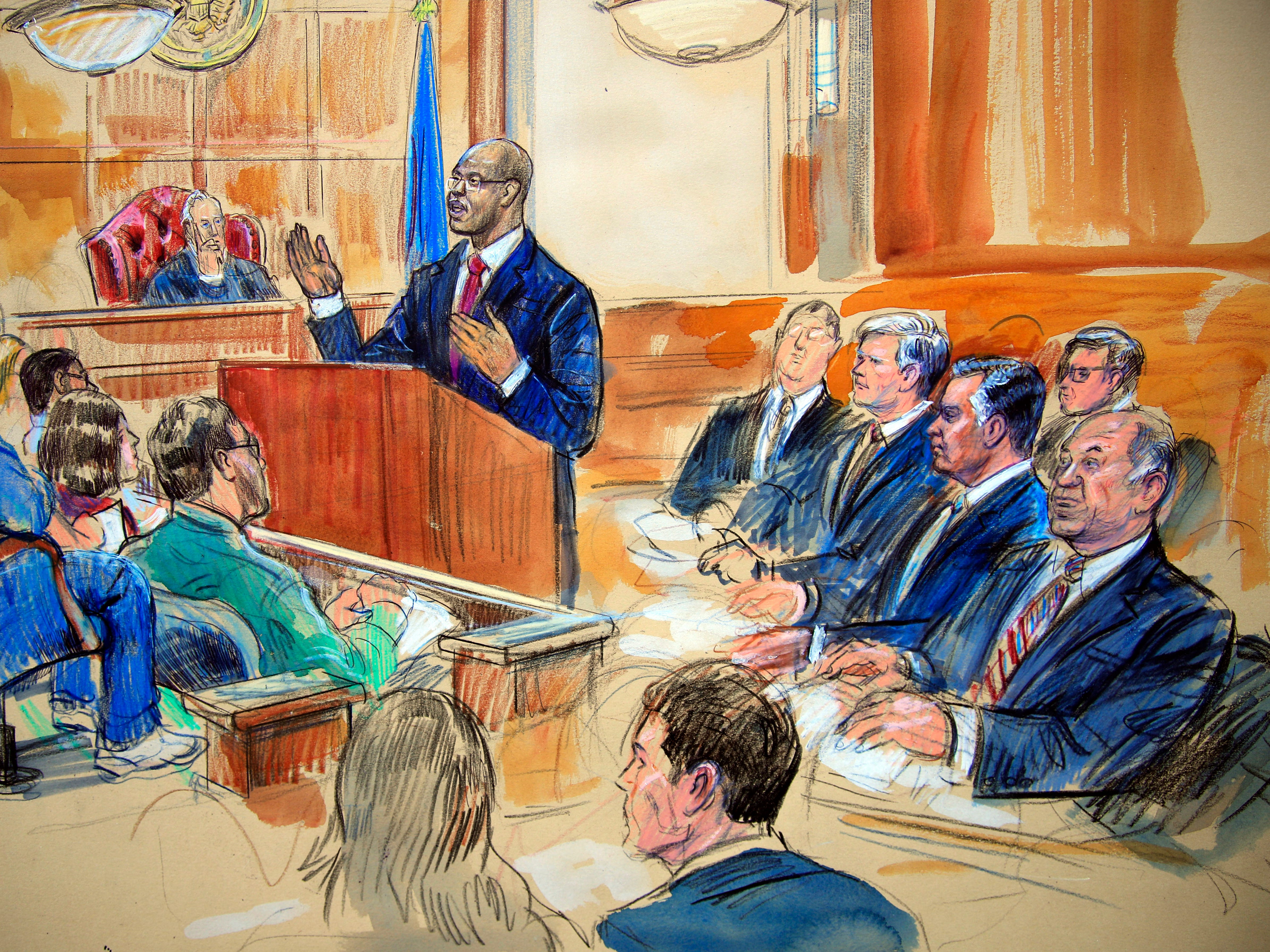 A courtroom sketch shows Paul Manafort, seated right row second from right (with his lawyers, the jury, U.S. District Court Judge T.S. Ellis III and Assistant U.S. Attorney Uzo Asonye) during opening arguments in the trial of President Trump's former campaign chairman on tax evasion and bank fraud charges.