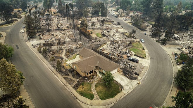 An aerial view of the homes of Harlan Drive and Bedrock Lane in the Lake Redding Estates neighborhood shows the devastation caused by the Carr Fire, which roared through the area late last week.