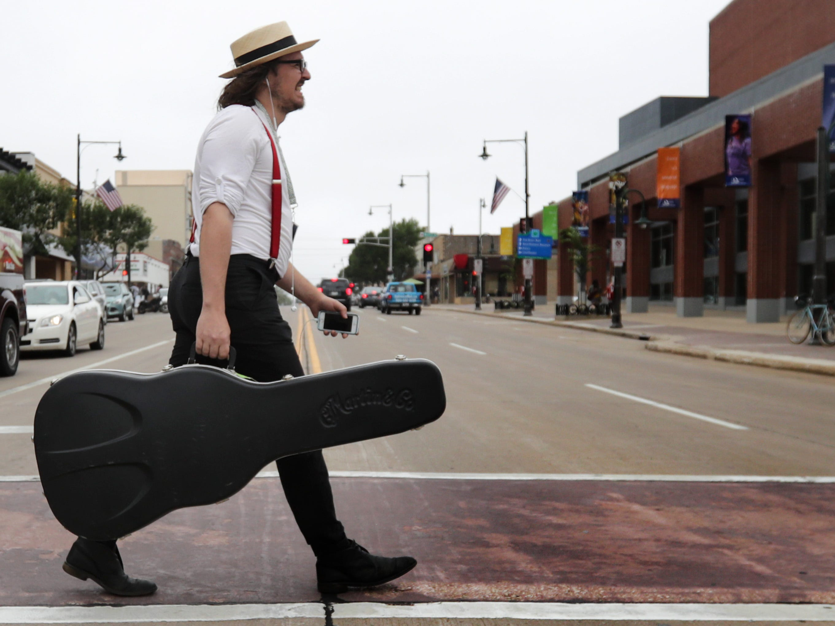 Adrian Krygowski, of Adrian and Meredith, walks to the Performing Arts Center for a Facebook Live event during the Mile of Music festival Thursday, August 2, 2018, in Appleton, Wis. Wm. Glasheen/USA TODAY NETWORK-Wisconsin