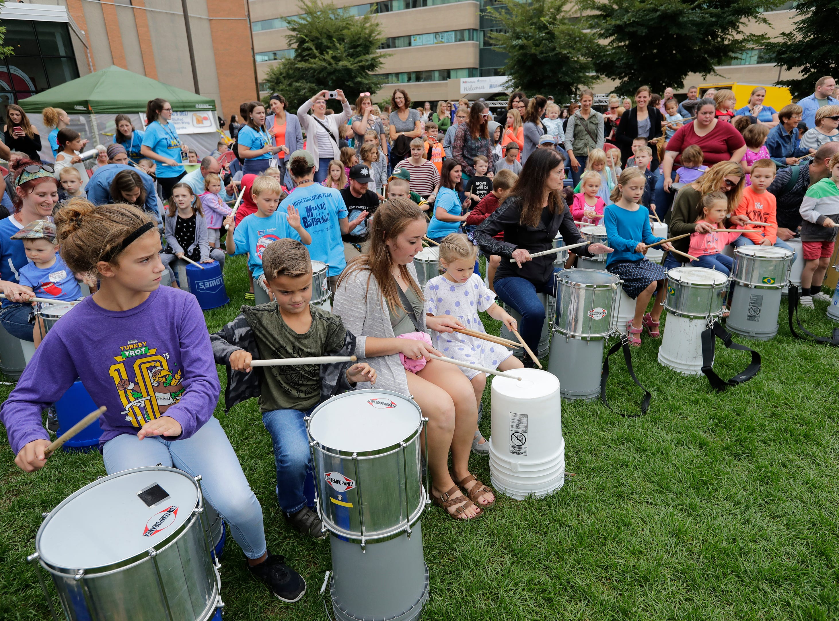 Houdini Plaza is packed with people learning to play Brazilian Samba Drumming during the Mile of Music Thursday, August 2, 2018, in Appleton, Wis.  Dan Powers/USA TODAY NETWORK-Wisconsin