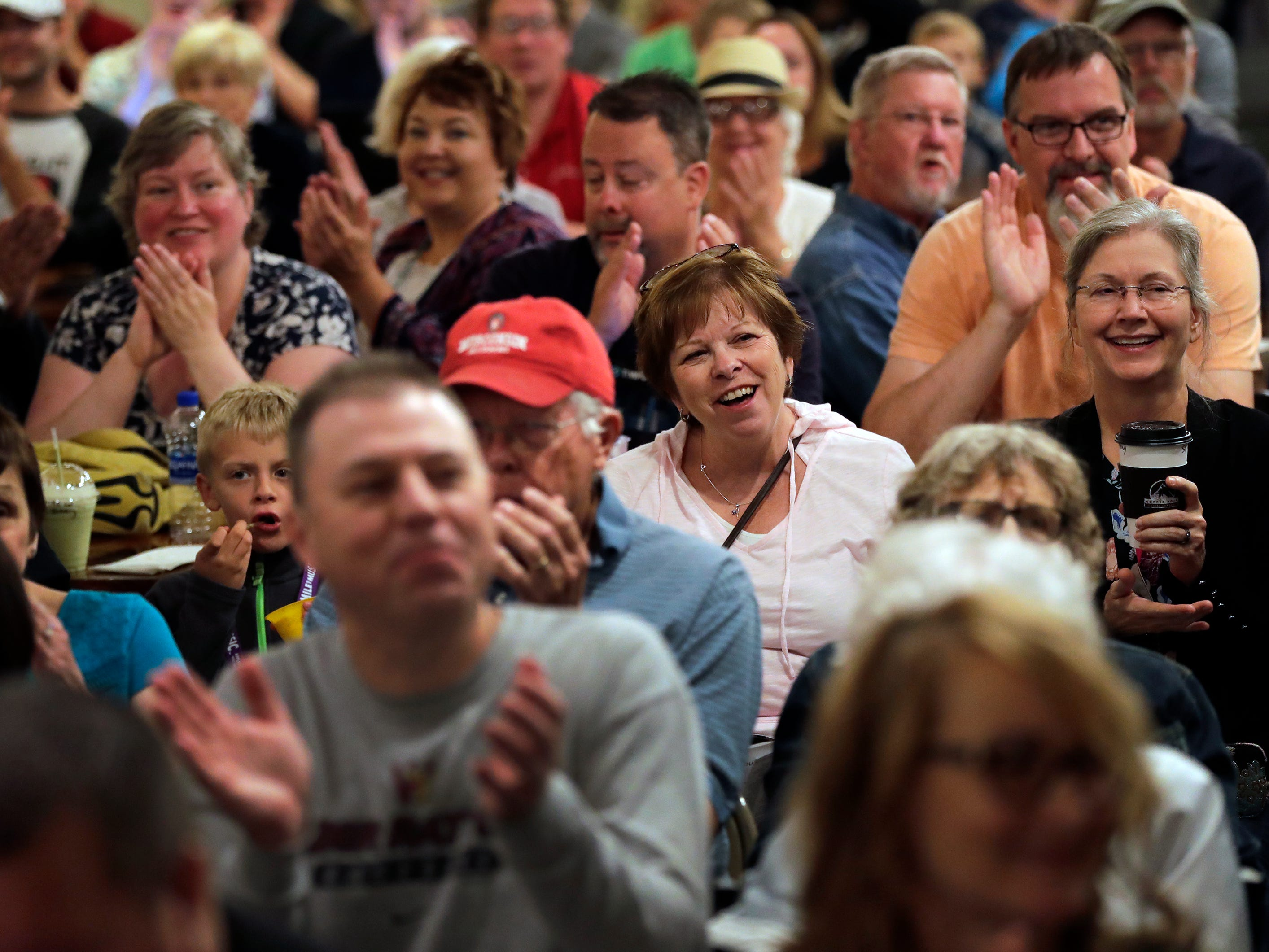 A large crowd welcomes Walt Hamburger as he kicks off Mile of Music during a performance at the Copper Rock Coffee Company Thursday, August 2, 2018, in Appleton, Wis.  Dan Powers/USA TODAY NETWORK-Wisconsin