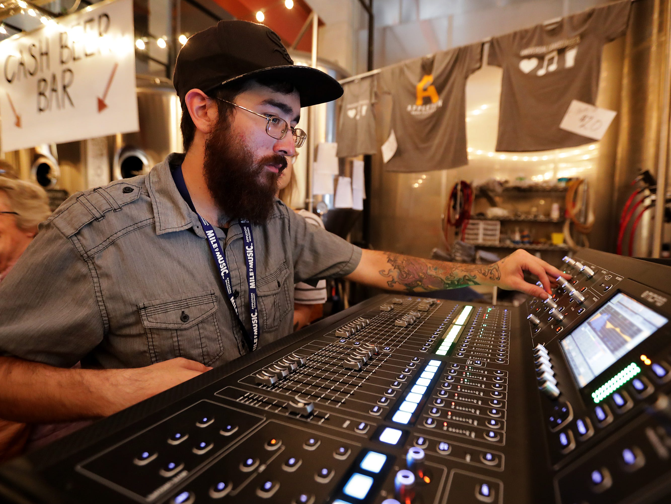 Marcus Granados works a soundboard during the Mile of Music festival Thursday, August 2, 2018, in Appleton, Wis. Wm. Glasheen/USA TODAY NETWORK-Wisconsin