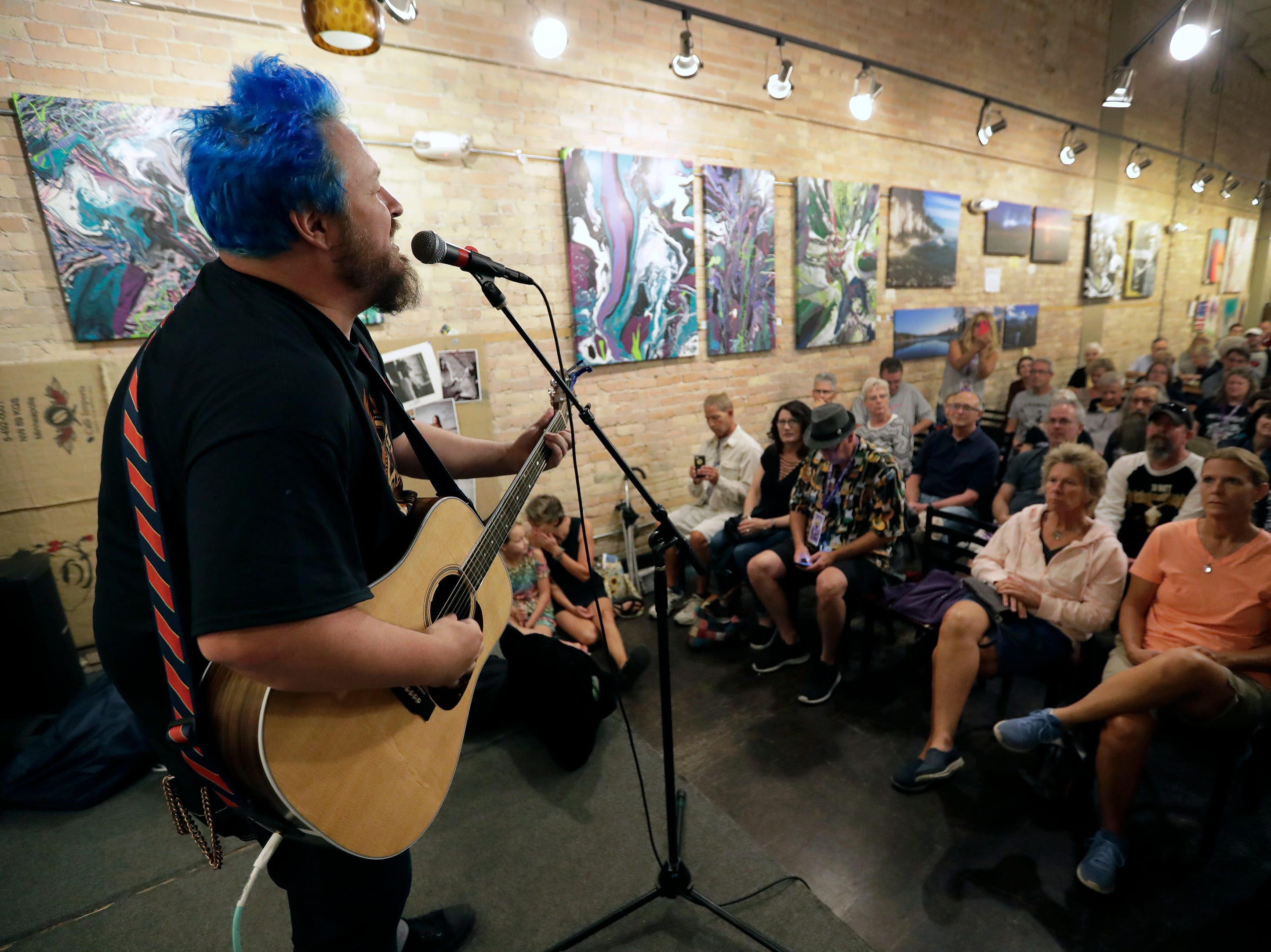 Walt Hamburger kicks off Mile of Music as he performs at the Copper Rock Coffee Company Thursday, August 2, 2018, in Appleton, Wis.  Dan Powers/USA TODAY NETWORK-Wisconsin