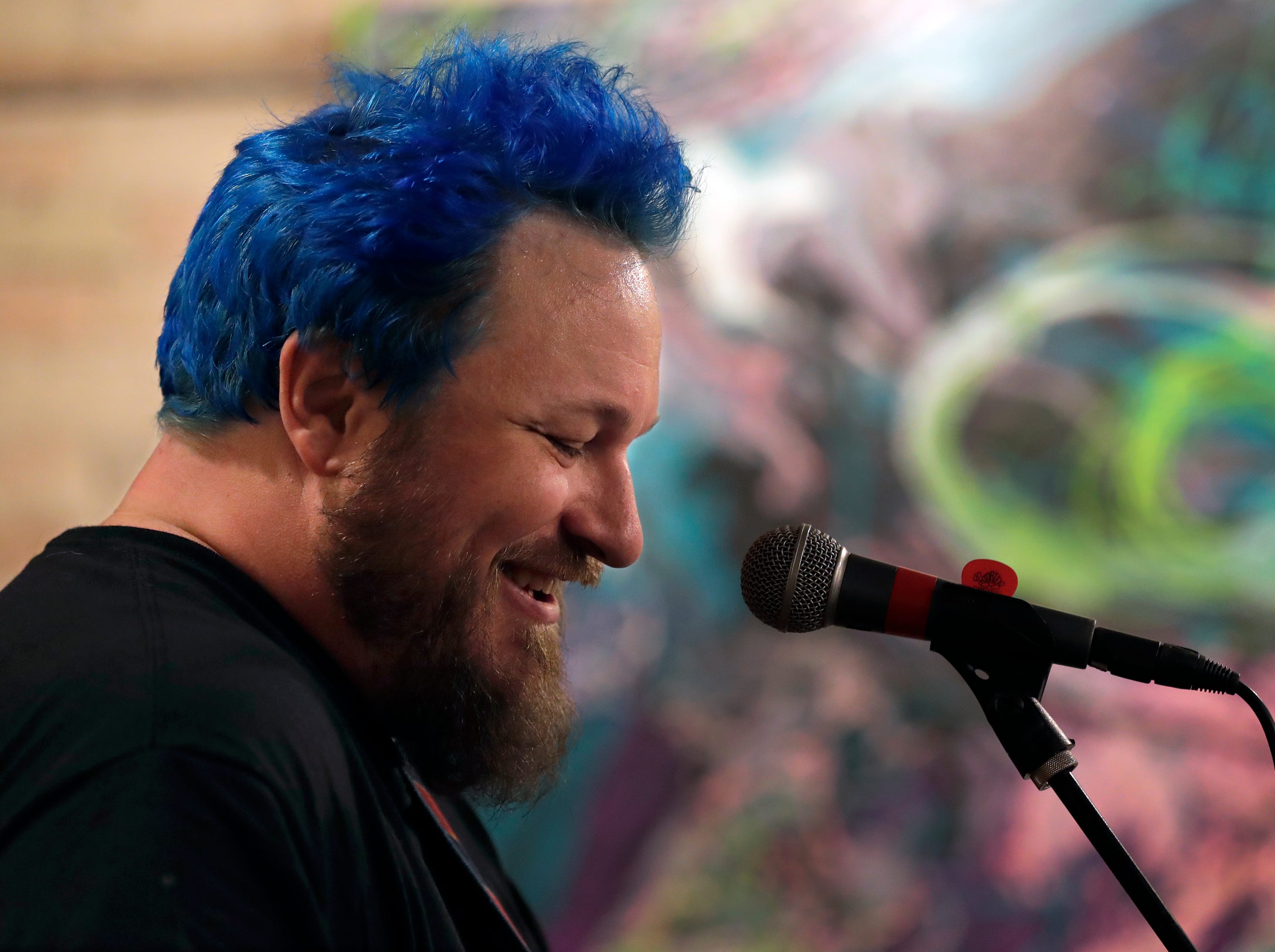 Walt Hamburger is all smiles while being applauded by a large crowd as he kicks off Mile of Music during a performance at the Copper Rock Coffee Company Thursday, August 2, 2018, in Appleton, Wis.  Dan Powers/USA TODAY NETWORK-Wisconsin