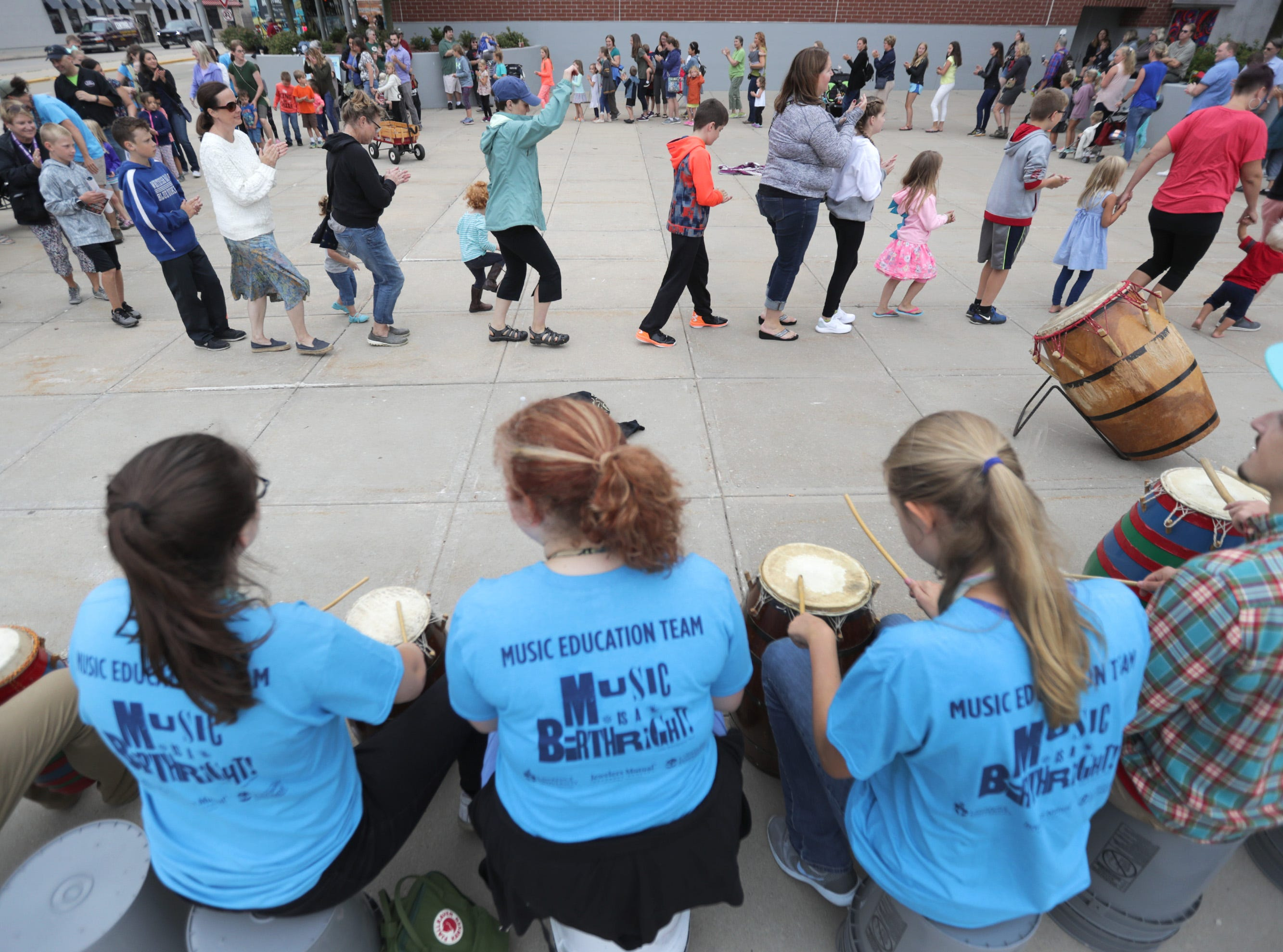 An interactive music education session of Ghanian drumming and dance at the PAC Thrivent Plaza during the Mile of Music festival Thursday, August 2, 2018, in Appleton, Wis. Wm. Glasheen/USA TODAY NETWORK-Wisconsin
