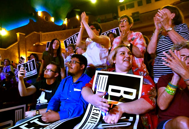 Attendees cheer U.S. Senate candidate Beto O'Rourke during a Democratic town hall meeting at the Paramount Theatre.