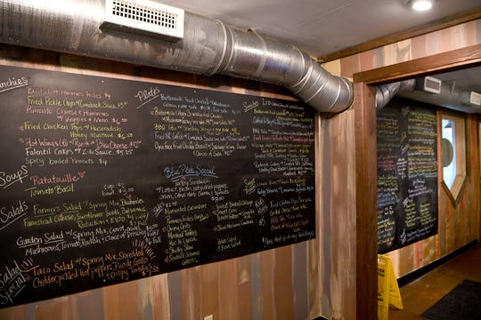 The menu is written in chalk on the wall at HomeGrown West on Amboy Road and focuses heavily on local and seasonal food so it changes often.