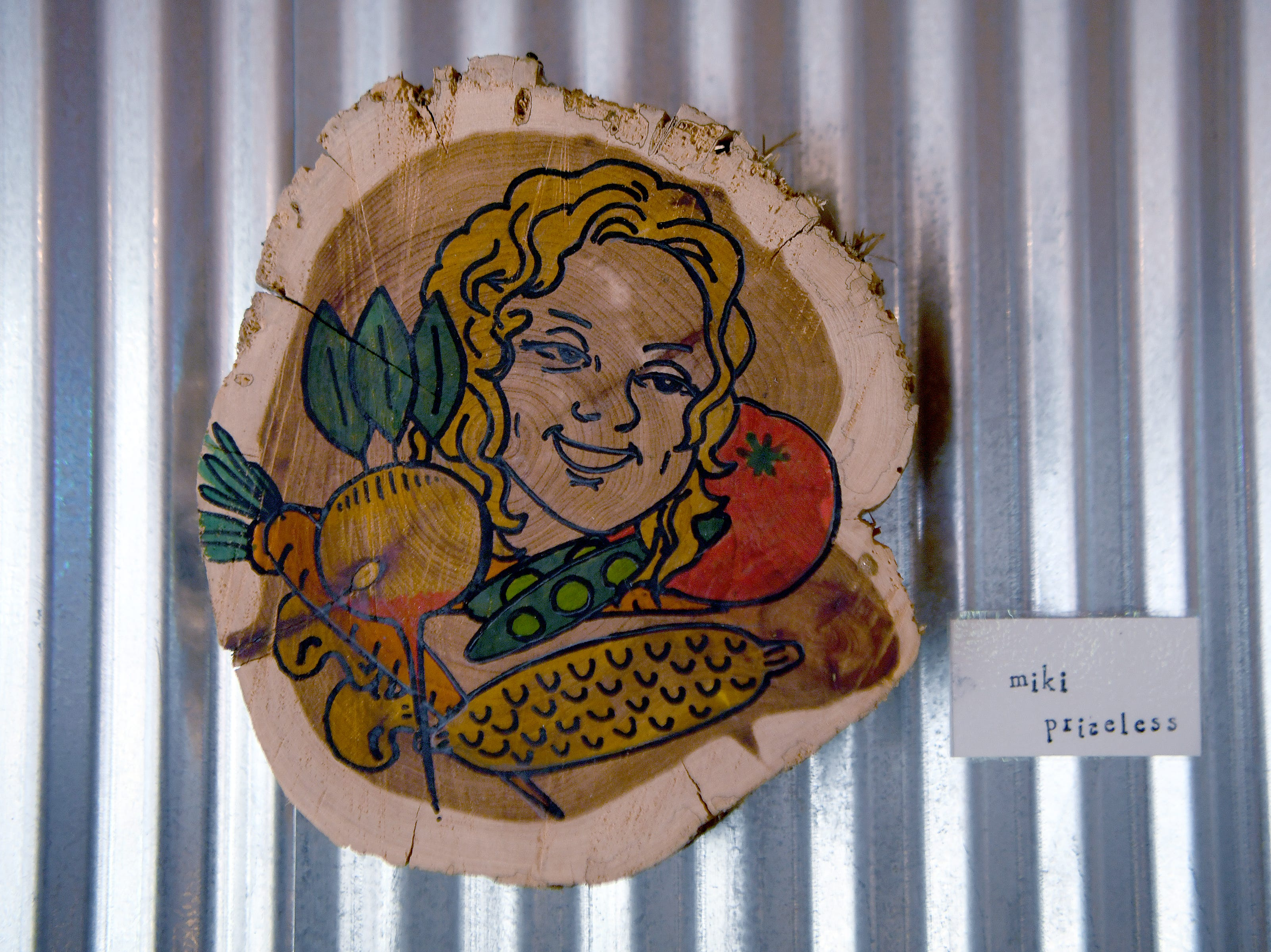 A piece of artwork on the wall of HomeGrown West is a nod to owner HomeGrown owner Miki Loomis.