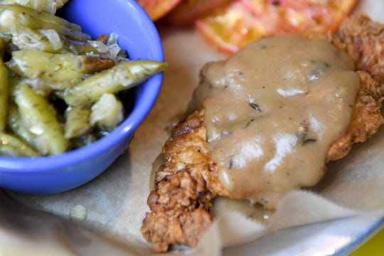 The buttermilk fried chicken at HomeGrown West on Amboy Road is served with mushroom gravy and is shown here with a green bean medley.