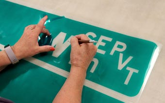 Kitsap County maintains more than 20,000 signs on roughly 900 miles of roadway. When signs need replacing, fabricator Lynn McLean is the one who designs and makes the new ones.