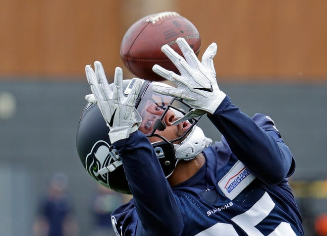Seahawks wide receiver Keenan Reynolds catches a pass during a June 12 offseason practice in Renton. Reynolds, a former star quarterback at the Naval Academy, received a waiver to delay his active duty service while he pursues a pro football career.