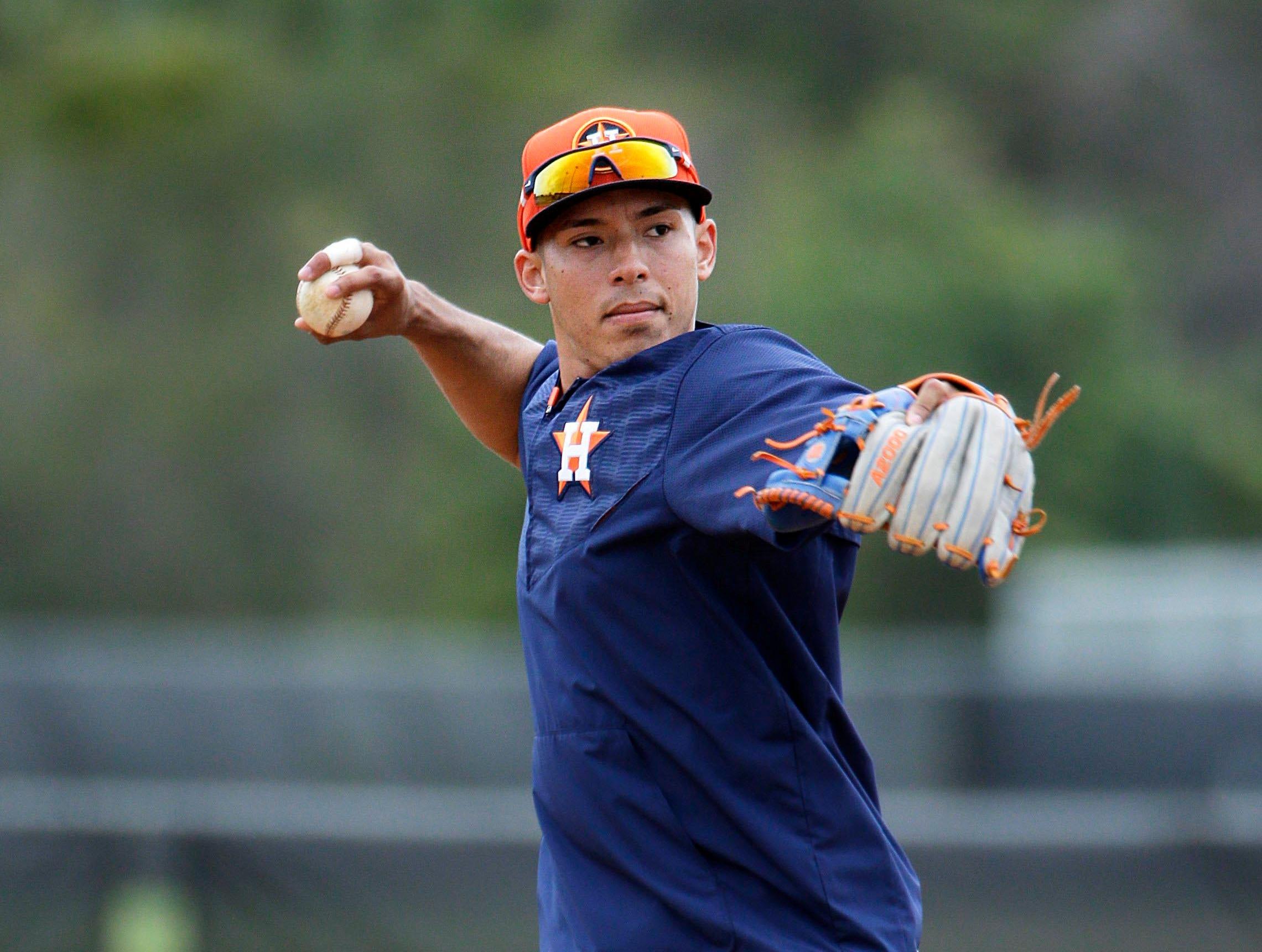 Houston Astros' Carlos Correa fields a ground ball during a spring training baseball workout, Thursday, Feb. 26, 2015, in Kissimmee, Fla. (AP Photo/David Goldman)