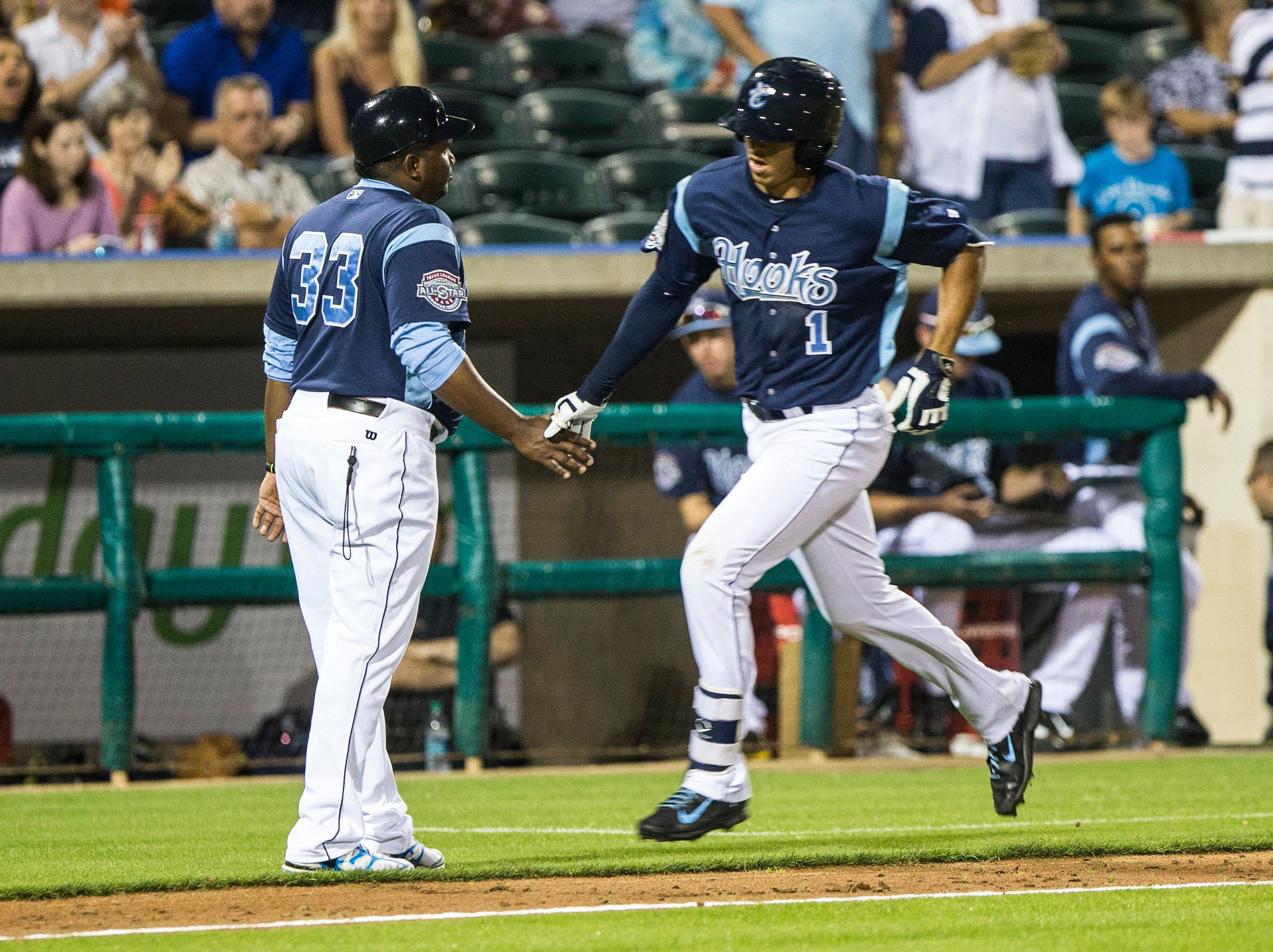 Andrew Mitchell/Caller-Times Corpus Christi Hooks' manger Rodney Linares shakes hands with Carlos Correas after his home run during their 2015 Texas League All Star Game the Houston Astros at Whataburger Field Thursday evening, April 2, in Corpus Christi.