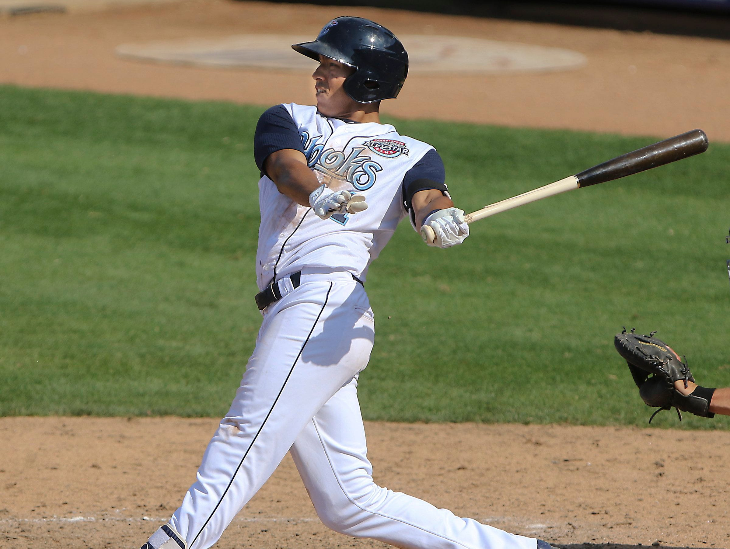GEORGE TULEY/SPECIAL TO THE CALLER-TIMES Carlos Correa picked up his second single to go with a double for a three hit day for the Hooks at Whataburger Field in Corpus Christi, Sunday, May 3, 2015.
