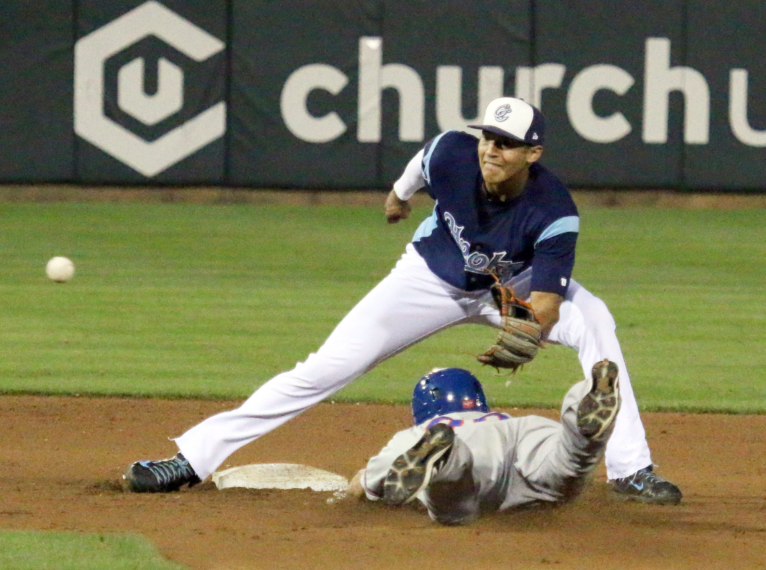 Erick Sifuentes/Special to The Caller-TimesMidland Rockhounds' Matt Angle beats the throw to Hooks' Carlos Correa for the steal at Whataburger Field Tuesday evening.