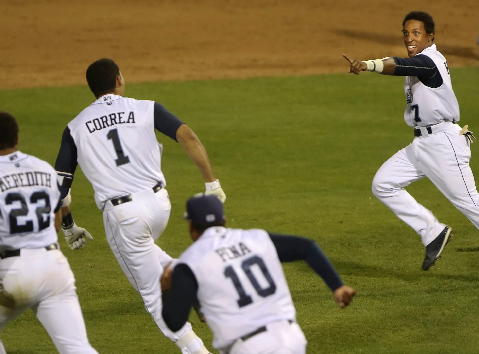 GEORGE TULEY/SPECIAL TO THE CALLER-TIMES Tony Kemp (R), who scored the winning run, points to Carlos Correa (1) whos bases-loaded two-out  Three-RBI double gave the Hooks a walk-off  5-4 win over Frisco at Whataburger Field in Corpus Christi, Monday, May 4, 2015.