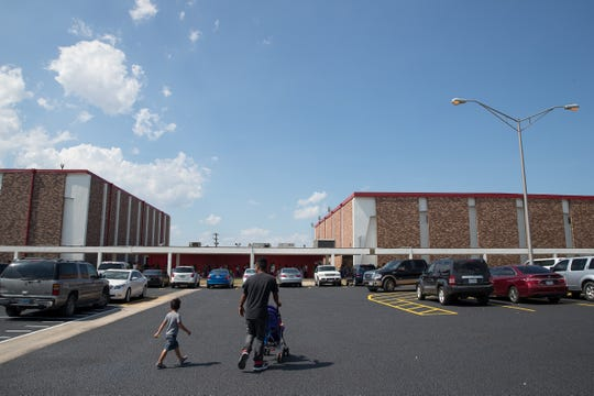 People walk to the line outside the Robstown High School Auditorium for the  6th Annual School Supplies Giveaway on Wednesday, Aug,1, 2018.