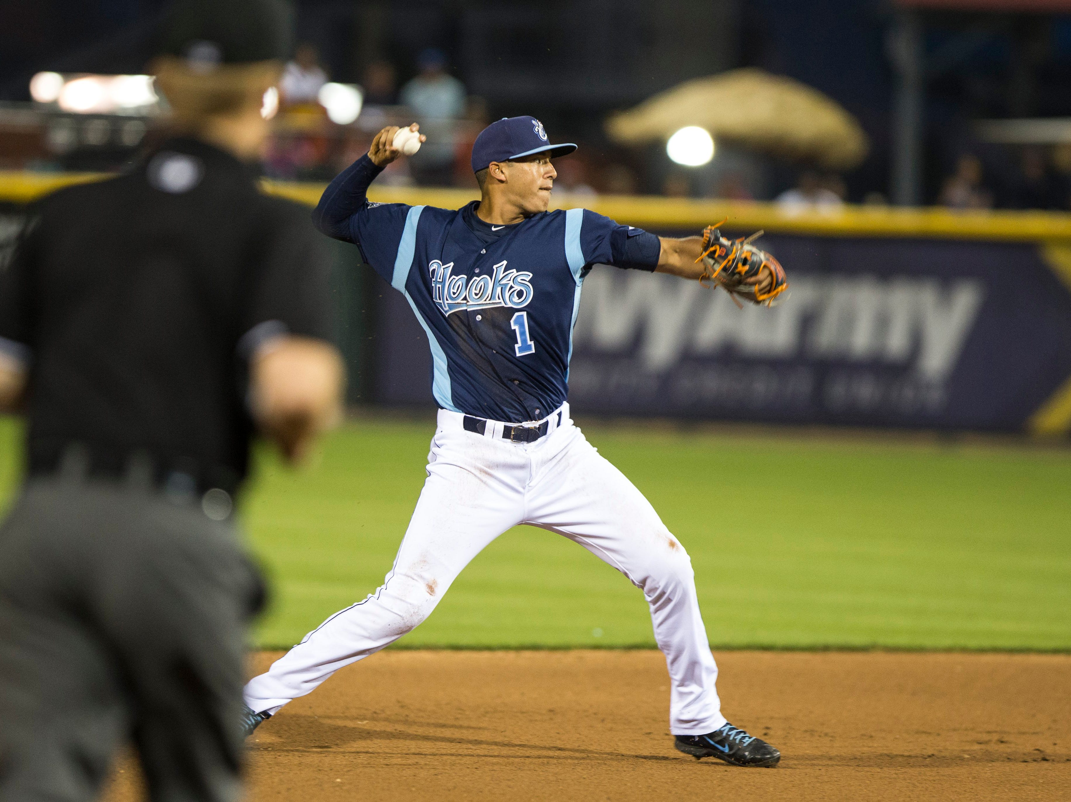 Andrew Mitchell/Caller-TimesCorpus Christi Hooks' Carlos Correa fields and throws the ball to first for an out during their 2015 Texas League All Star Game against the Houston Astros at Whataburger Field Thursday evening, April 2, in Corpus Christi.