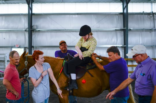 Kierstin Leigh Stump, 25, who has cerebral palsy, has been riding horses since she was 2 years old.