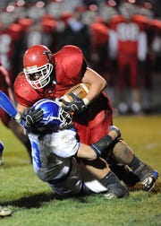 Chillicothe linebacker Shay Netter makes a stop against Logan Elm during the second round of the 2008 playoffs on at Teays Valley.