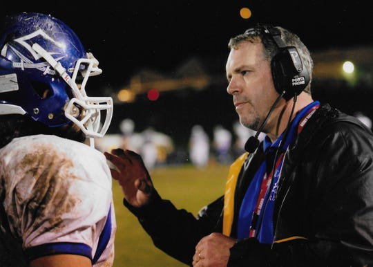 Shay Netter talks with coach Jeff Metzler during a Chillicothe football game.
