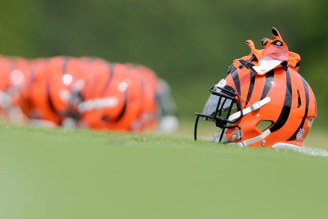 A Cincinnati Bengals helmet rests on the field during Cincinnati Bengals training camp practice, Wednesday, Aug. 1, 2018, on the practice fields next to Paul Brown Stadium in Cincinnati.