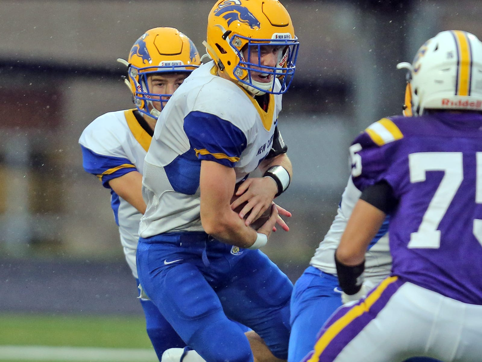 Kyle Kelly runs the ball for the New Cath Thoroughbreds against Campbell County.