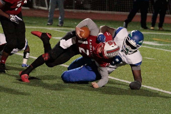 Big Anthony Booker of Winton Woods comes in almost untouched and gets a sack on La Salle quarterback, Griffin Merritt.  Winton Woods defeated La Salle in the Regional Final 16-14 Friday Night, November 17, 2017 at Withrow International High School.