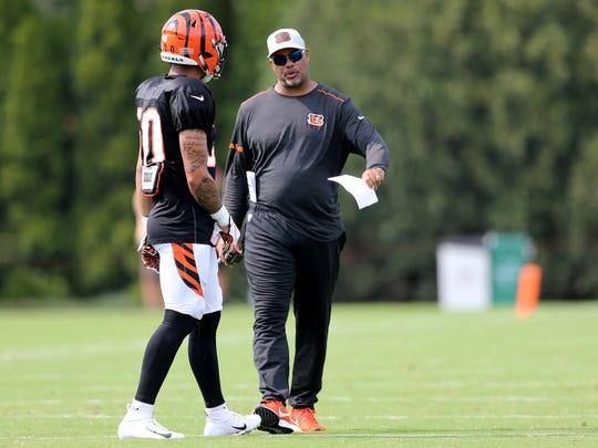 Cincinnati Bengals defensive coordinator talks with Cincinnati Bengals defensive back Jessie Bates (30) during Cincinnati Bengals training camp practice, Wednesday, Aug. 1, 2018, on the practice fields next to Paul Brown Stadium in Cincinnati.