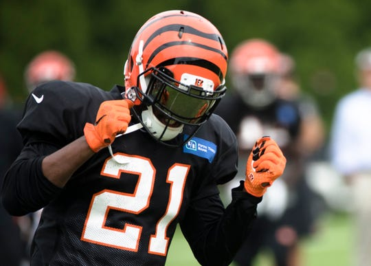 Cincinnati Bengals defensive back Darqueze Dennard (21) reacts to dropping an interception during Cincinnati Bengals training camp practice, Thursday, Aug. 2, 2018, on the practice fields next to Paul Brown Stadium in Cincinnati.