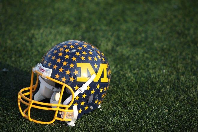 A vintage Crusaders' football helmet sits on the Michael A. Stofko Memorial Field at Archbishop Moeller High School,  November 2012.