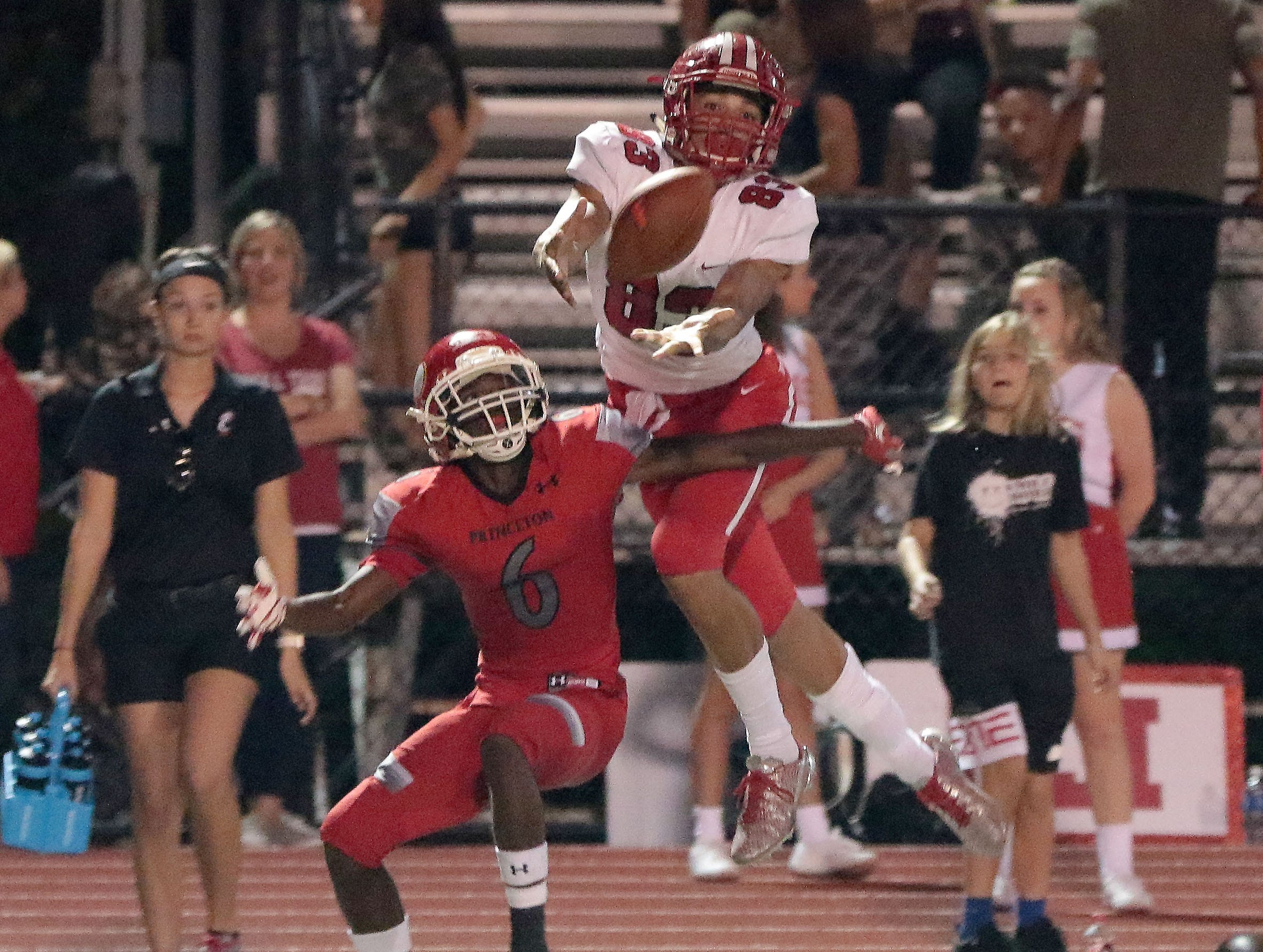 Fairfield's Erick All (83) goes up for the ball over Princeton's Demarcus Hill during their football game, Friday, Sept. 22, 2017.