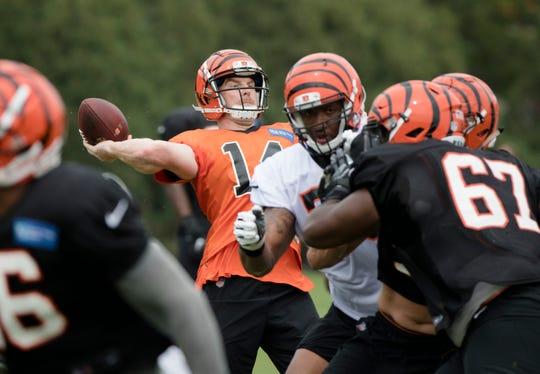 Cincinnati Bengals quarterback Andy Dalton (14) throws a pass during Cincinnati Bengals training camp practice, Thursday, Aug. 2, 2018, on the practice fields next to Paul Brown Stadium in Cincinnati.