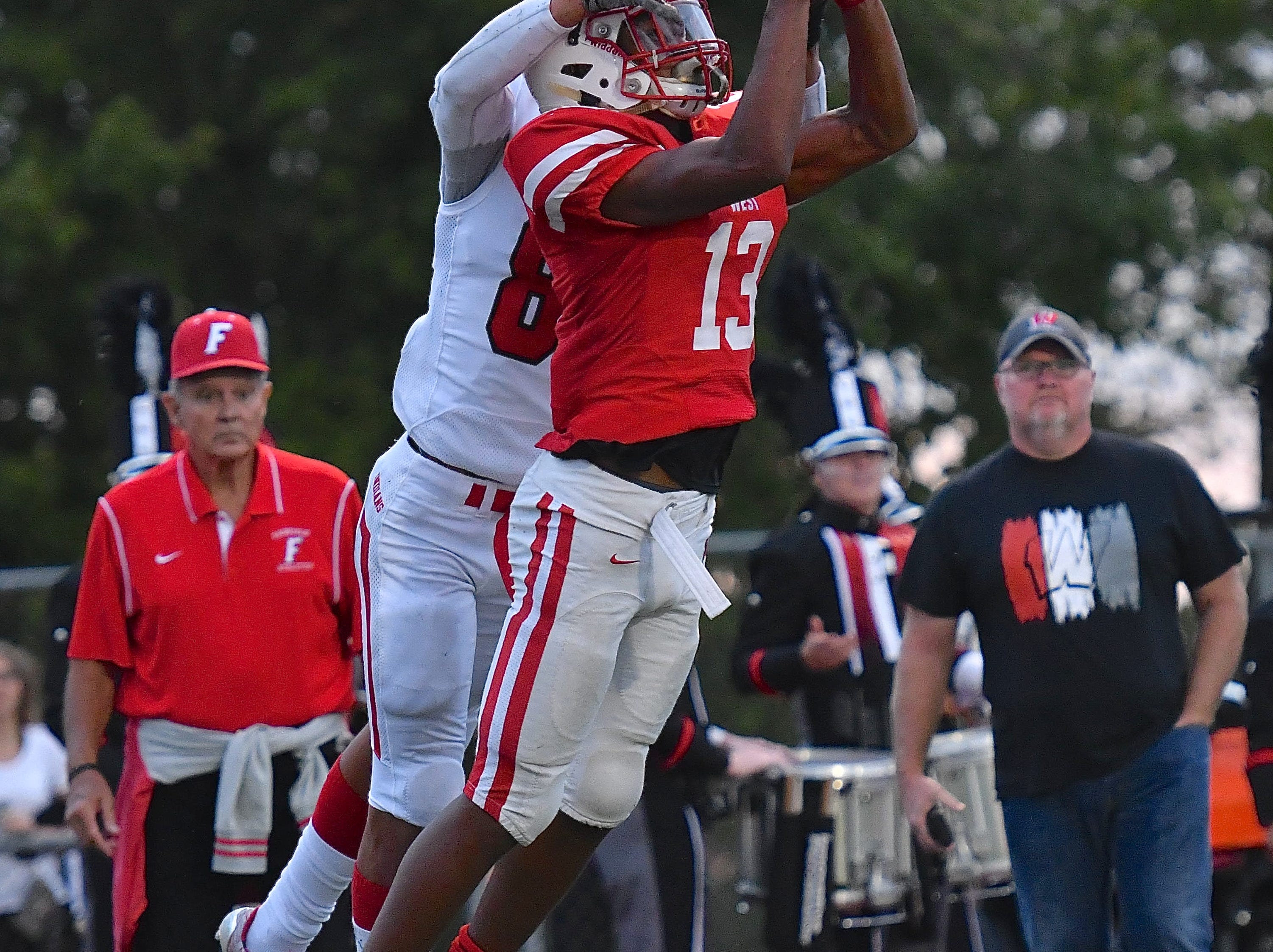 Lakota West's Jeremiah Ross intercepts a pass in the end zone for the Firebirds Friday, September 8th at Lakota West High School