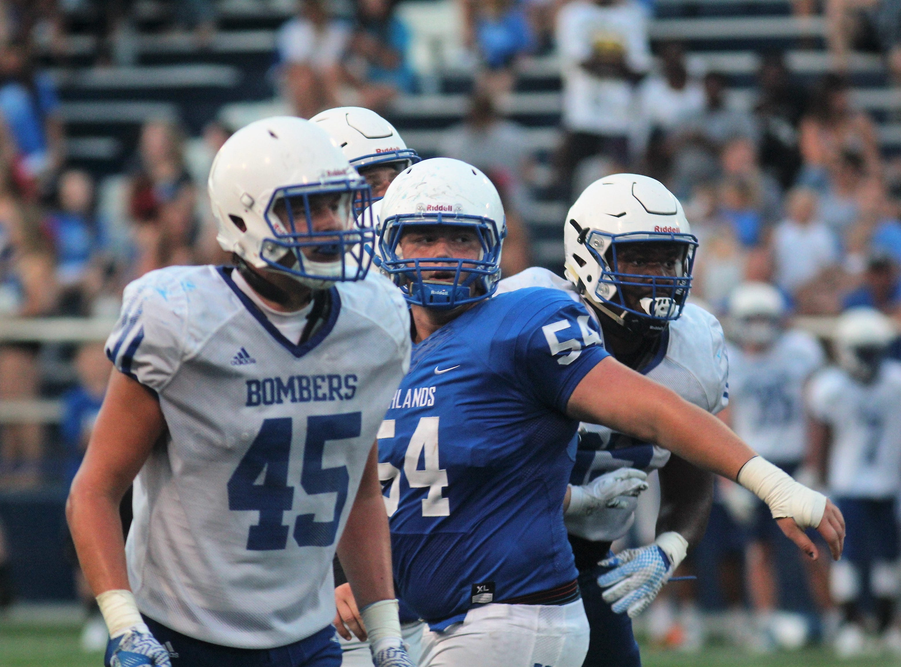 St. Xavier DL Thomas Kiessling looks for the ball. during a football scrimmage featuring the Cincinnati St. Xavier Bombers at Highlands Bluebirds Aug. 11, 2017. St. X won 38-3.