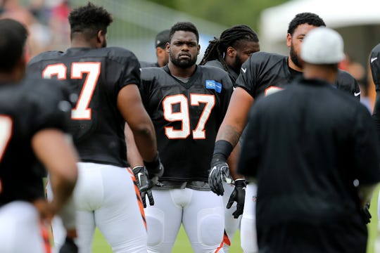 Cincinnati Bengals defensive tackle Geno Atkins (97), center, waits for the start of Cincinnati Bengals training camp practice, Wednesday, Aug. 1, 2018, on the practice fields next to Paul Brown Stadium in Cincinnati.