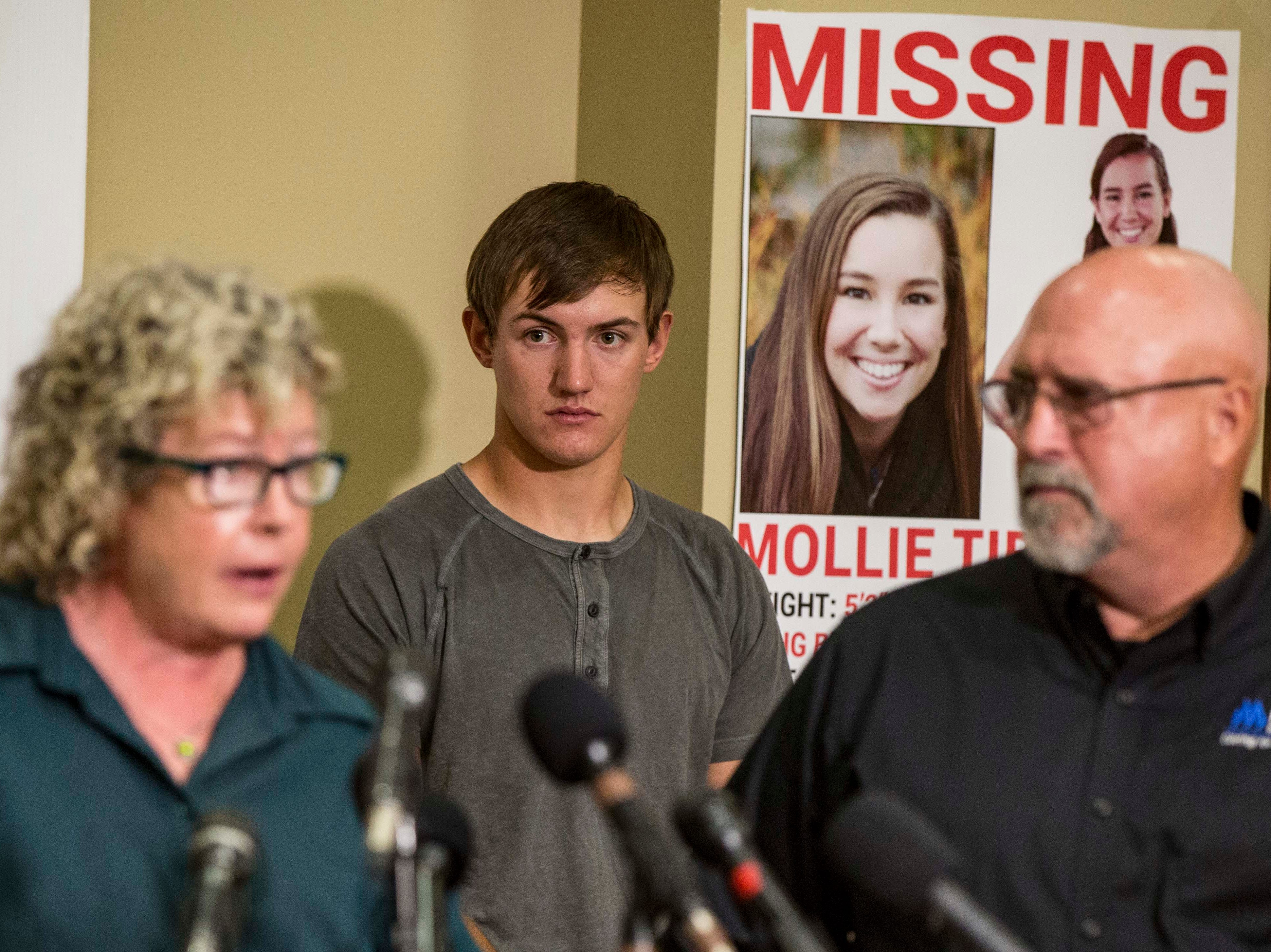 "Dalton Jack, Mollie's boyfriend, watches as Laura Calderwood mother of the missing 20-year-old University of Iowa student Mollie Tibbetts answers questions during a press conference announcing a ""Bring Mollie Tibbetts Home Safe Reward Fund"" Thursday, Aug. 2, 2018, in Brooklyn, Iowa."